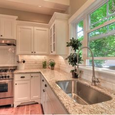 Giallo Ornamental Granite, beveled white subway tile back splash and white cabinets. Wish I had that window!