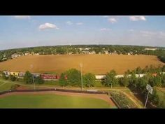 Flying the newest DJI Phantom 2 Vision Plus over a baseball field, truck and train!  Please share and enjoy my other drone videos too!  Filmed with DJI Phantom 2 Vision Plus with DJI camera 1080P 30FPS!