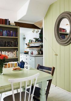 dining room in a scottish cottage that doubles as a library | interior design + decorating ideas