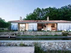 Architectual firm Ábaton transformed an abandoned stable into a stone estate in the province of Cáceres, Spain.