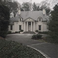 Limestone Boxwoods - Instagram (@limestonebox) - A white on white house with slate roof in the Brookhaven neighborhood of Atlanta.