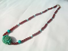 Carved turquoise burgundy carnelian beaded by goodkarmanyc on Etsy, $65.00