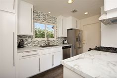 #JustListed 3514 Kenora Drive. This recently #renovatedhome has a custom kitchen with countertops, new appliances and new hardwood flooring. #HomesForSale #SanDiegoHomes