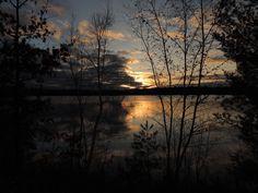 Sunrise over Big Carr Lake WI by Ken Groezinger