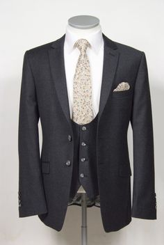 Grooms wedding suit grey pure wool flannel  slim fit 2 button single breasted suit with narrow notch lapel and scoop neck waistcoat to purchase £645 for a 3 piece suit. Shown here ingrey flannel with liberty print tie & hank, available in other colours and cloths #groom #wedding #suit #bespoke #madetomeasure #grey #waistcoat #scoop