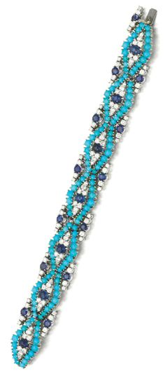 Turquoise, sapphire and diamond bracelet, 1960s.  Set with cabochon turquoises, sapphires and brilliant-cut diamonds, length approximately 185mm. Via Sotheby's.