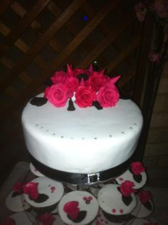 Hot pink and black wedding cake with cupcakes