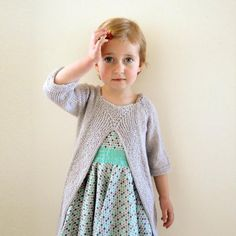 """The pattern includes instructions for both the tunic and the pullover!""""Leksak"""", meaning """"toy"""" in Swedish, is an intriguing top-down pullover for both boys and girls! Slightly cropped sleeves that don't get in the way, and with a different and decorative take on the front panel. Most of the garment is worked flat, but still manages to be completely seamless. A perfect sweater for keeping the little ones warm while playing! The pattern includes instructions for both the closed pullover and the…"""