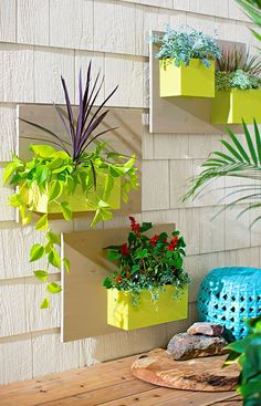 These wall-mounted planters made from flat wood panels and boxes can go vertically or horizontally. Mix the combinations and arrange them to suit your space. #DIY #garden #spring #summer