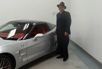 2011 Corvette Dream Giveaway winner Gary Burrell with his 2011 Hero Edition ZR1 in Detroit during the awards ceremony.