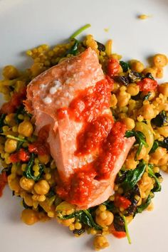 Baked spicy salmon served with nutty Israeli couscous & chickpeas and drizzled with harissa.