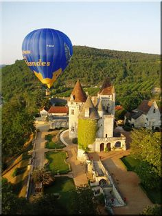 Hot air balloon over Milandes, Dordogne region. The chateau is mostly known by it's previous owner, Josephine Baker, controversial black musical hall star who on occasion enjoyed walking her pet cheetah around the streets of Paris to freak out the locals. Strange but apparently true.