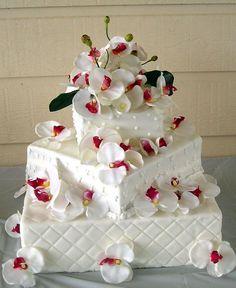 Google Image Result for http://static.weddingcometrue.com/weddcometrue/2011/01/square-wedding-cakes.jpg