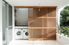 An Apartment in Valencia Gets an Airy Renovation - Design Milk rh Studio redesigned an apartment in Valencia, Spain for a couple by removing walls and renovating Hidden Laundry, Small Laundry, Concealed Laundry, Modern Laundry Rooms, Laundry In Bathroom, Laundry Room Doors, Laundry Closet, Outdoor Laundry Area, Outside Laundry Room