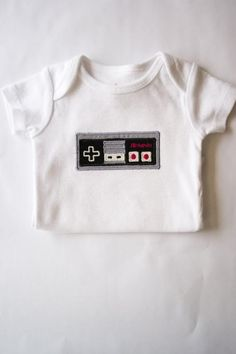 Nintendo Controller baby onesie - for your little geeky gamer.