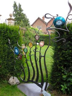 Glass and metal gate - very cool, but I don't think it would keep the dog in!