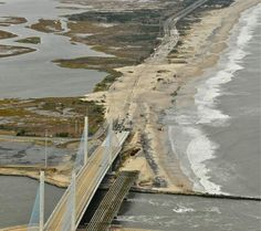 Hurricane Sandy pushes dunes over Rt.1 at Indian River Inlet Bridge.  The ocean is so powerful.