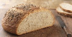 This sourdough loaf is enhanced with whole grains and a generous topping of seeds. Multi-Grain Sourdough Boule Recipe | King Arthur Flour