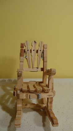 Clothespin rocking chair with some springs left on for decoration ($25.00)
