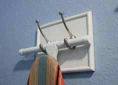 Out-of-the-Way Ironing Board... This wall-mount solution will keep your ironing board out of the way, but still within reach. Frame an old piece of scrap wood, and paint it a color that complements your laundry room scheme. Affix spare hooks to the front, and then secure the project to the wall using brackets. Hang your board on the hooks for the finishing, storage-smart touch. .