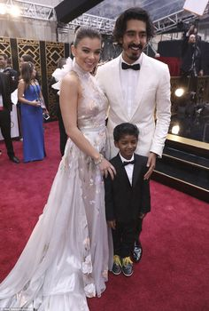 Getting to know you: Hailey poses with Lion stars Sunny Pawar and Dev Patel...