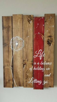 Everyone loves the delicateness of a dandelion.. The dandelion symbolizes survival, healing and clarity  Paired with the quote : Life is a balance of holding on and letting go… I believe everyone can relate to in one aspect or another. This sign measures 17 X 24 and is stained in a dark walnut, red stripe on one of the boards then hand painted in ivory/white lettering. I am able to change the color of the stripe if you desire something different, please just send me a message. All of my…