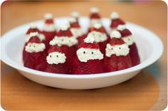 Strawberry Santas - strawberries with mixture of whipped cream and peach liquor & black sesame seeds for eyes