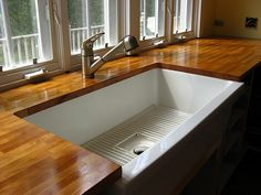 Ikea wood countertop with undermount sink.. Describes what she used to protect it.