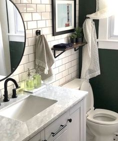 Elsie Larson Bathroom Reveal | Here's how to fit more towels and toiletries into a tiny bathroom.