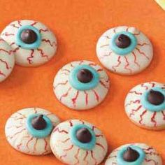 Eyeball Cookies Recipe by Holiday Cottage.  http://www.holidaycottagepage.com/eyeball-cookies-recipe/ I think these would be terrific fun for a Halloween party.