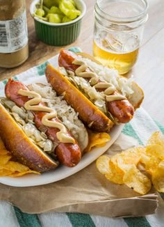 German Smokies in Fresh Pretzel Buns. Take your hot dogs to the next level! Fresh pretzel buns, smokies, grilled onions, sauerkraut and mustard. Wrap Recipes, Pork Recipes, Dinner Recipes, Sausage Recipes, Pretzel Bun, Pretzel Dogs, German Sausage, Burger Dogs, Burgers