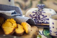 The Artichoke design is our newest #design. It features a stylised #artichoke motif in blue, with a matching blue borders. All our ceramics are #handmade and #handpainted by our #artisans here in the #Algarve Available from www.porchespottery.com  #butterdish #bread