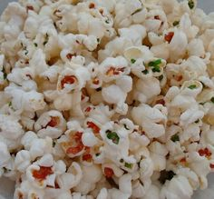 Happier Than A Pig In Mud: Colored Popcorn - add food dye to unpopped popcorn.  After it is popped, the husks are still colored.
