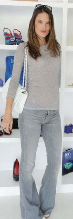 Who made Alessandra Ambrosio's flared jeans, white handbag, and sneakers?