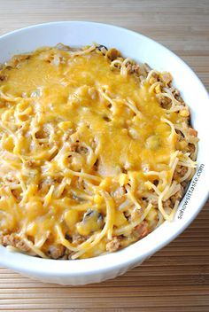 Taco Spaghetti - just like taco salad, but with spaghetti! Cheese, hearty beef, tangy olives and sour cream.