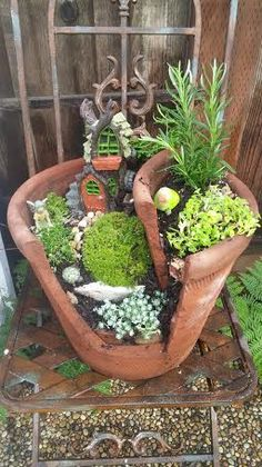 First fairy garden project ever by sisters Denise and Pam. So fun! Used broken planter. Small Garden Fairies, Fairy Garden Pots, Garden Angels, Fairy Garden Houses, Gnome Garden, Broken Pot Garden, Garden Features, Diy Planters, Miniature Fairy Gardens