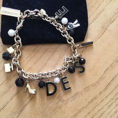 Brand new Dolce Gabbana desire charm bracelet. One of a kind Dolce Gabanna charm bracelet. Charm bracelet says desire. It also has other cute charms included. Pouch included. Dolce & Gabbana Jewelry Bracelets