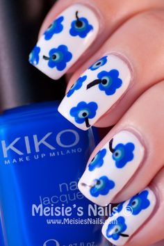 White nails with blue flowers. Love the retro style pattern on these and the colours look fab.