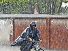 A man rides a bicycle through a first monsoon rain in Kathmandu, Nepal on June 21, 2015. Monsoon season in Nepal started in June.  Narendra Shrestha, EPA