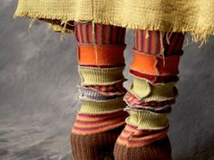 Patchwork leg warmers with exposed serging from Ethyria. Another project for old sweaters!
