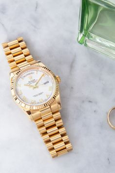 As the watch of presidents, popes and other notables, the 36 mm Rolex Day-Date (ref. 118238) surrounds itself with an aura of power and success. Made of pure yellow gold, this Rolex dress watch features a fluted bezel, a white dial with Roman indices and the famous president band, and is water resistant up to a depth of 100 meters! Famous Presidents, Rolex Models, Rolex Day Date, Luxury Watch Brands, Rolex Watches, Roman, Finding Yourself, Dating, Success
