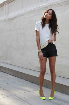 white t-shirt, black shorts. Green heels. Watch. Simple casual street style apparel. Summer fashion