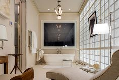 The beige bathroom takes a break from color, offering a soothing space to unwind.