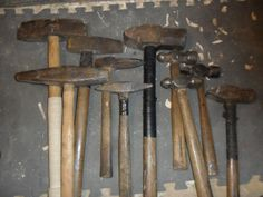 nice collection of old hammers including a big cross peen sledgehammer, a handled punch for driving railroad spikes and a few ball peen hammers.