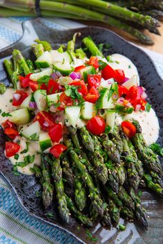 Smokey grilled asparagus in a tasty tahini sauce with lemon and maple along with fresh diced tomatoes and cucumbers! Grilled Fruit, Grilled Asparagus, Grilled Vegetables, Mozzarella Bread Recipe, Lemon Tahini Sauce, How To Cook Asparagus, Veggie Side Dishes, Cooking On The Grill, Salad Ingredients