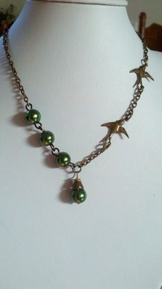 Green pearls and dove necklace