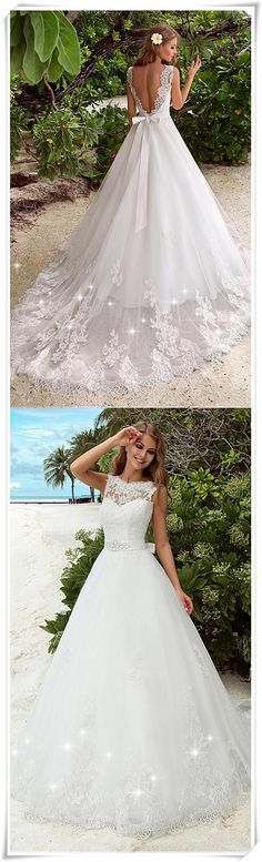 Alluring lace A-line wedding dresses. A beautiful big bowknot on the back wasit elevate the look.
