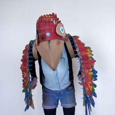 Way More Than a Box - Wearable Parrot Costume Project at WayMoreThanABox.com -- Amazing cardboard costume, filled with color, hundreds of feathers, and fully articulated movement! I believe you can fly!