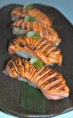 Blow Torched Salmon Nigiri, pickled ginger & kizami wasabi - One of my faves! Think Food, Love Food, Seafood Recipes, Cooking Recipes, Cooking Pork, Sushi Roll Recipes, Food Porn, Sushi Love, Food Presentation