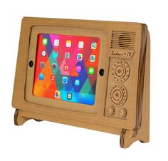 This cute cardboard stand turns your iPad or iPad Air into a retro TV. The iPad TV Stand measures wide X tall X deep, and it's made of cardboard and com… Karton Design, Retro Tv Stand, Cardboard Design, Big Screen Tv, Tablet Stand, Phone Stand, Gadget Gifts, Tech Gifts, Stand Design